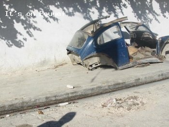 Old abandoned car carcass on Haiti sidewalk