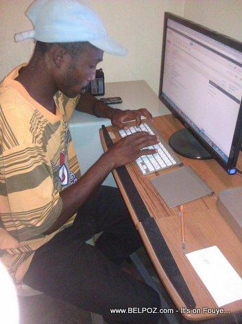 My Cousin Fenik typing on a mac