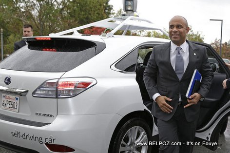 Haiti prime minister Laurent Lamothe getting out of the Google driverless car