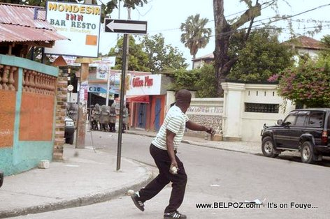 Haiti - Protester throwing rocks at Police