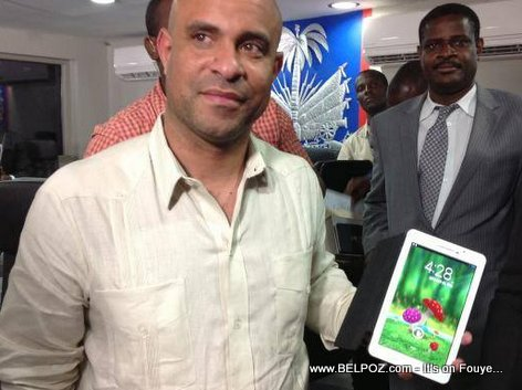PM Laurent Lamothe holding an Android Tablet MADE IN HAITI