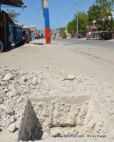 Gonaives Haiti - Holes being dug on the sidewalks for trees...