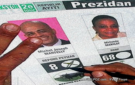 PHOTO: Haiti Election Ballot - A voter votes for Martelly in the 2010 Presidential Elections
