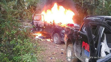 Haitian police vehicle on fire - Thiotte Haiti