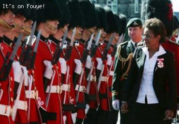 Michaelle Jean  inspects the guard as she leaves Parliament Hill in Ottawa
