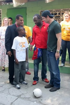 Wycleff Jean and Brad Pitt in Haiti