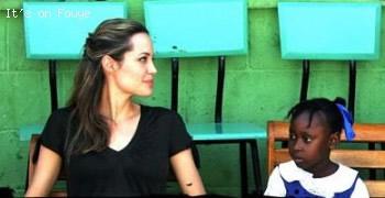 Angelina Jolie a Haitian girl in Haiti