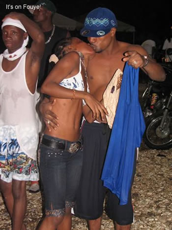 Haitians kissing at the beach