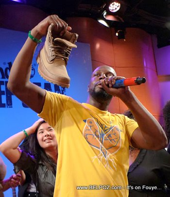 Wyclef Jean Holding Timberland Earthkeepers Boots