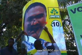 Haiti Protestors Spray Painting Jude Celestin Photo
