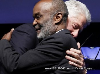 President Bill Clinton And President Rene Preval Hugging Eachother
