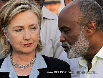 Hillary Clinton And President Rene Preval In Haiti