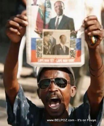 Demonstrator Holding President Aristide Photo